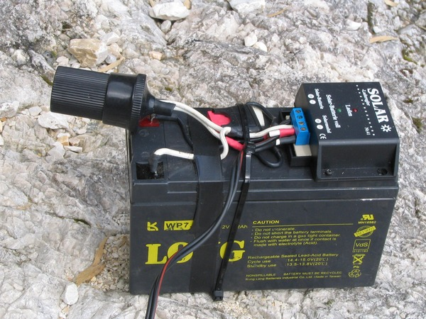 Sealed lead acid battery with charge regulator The charge regulator is simple with double sided adhesive tape glued on the sealed lead acid battery. Also this should be only a temporary stopgap.